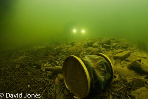 Bucket in the lake with camera in background