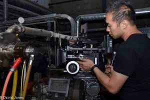 Cameraman making adjustments