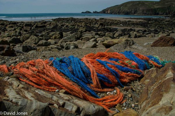Discarded fishing nets on a beach in Wales