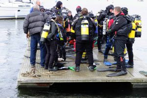 Divers heading out to drop off point