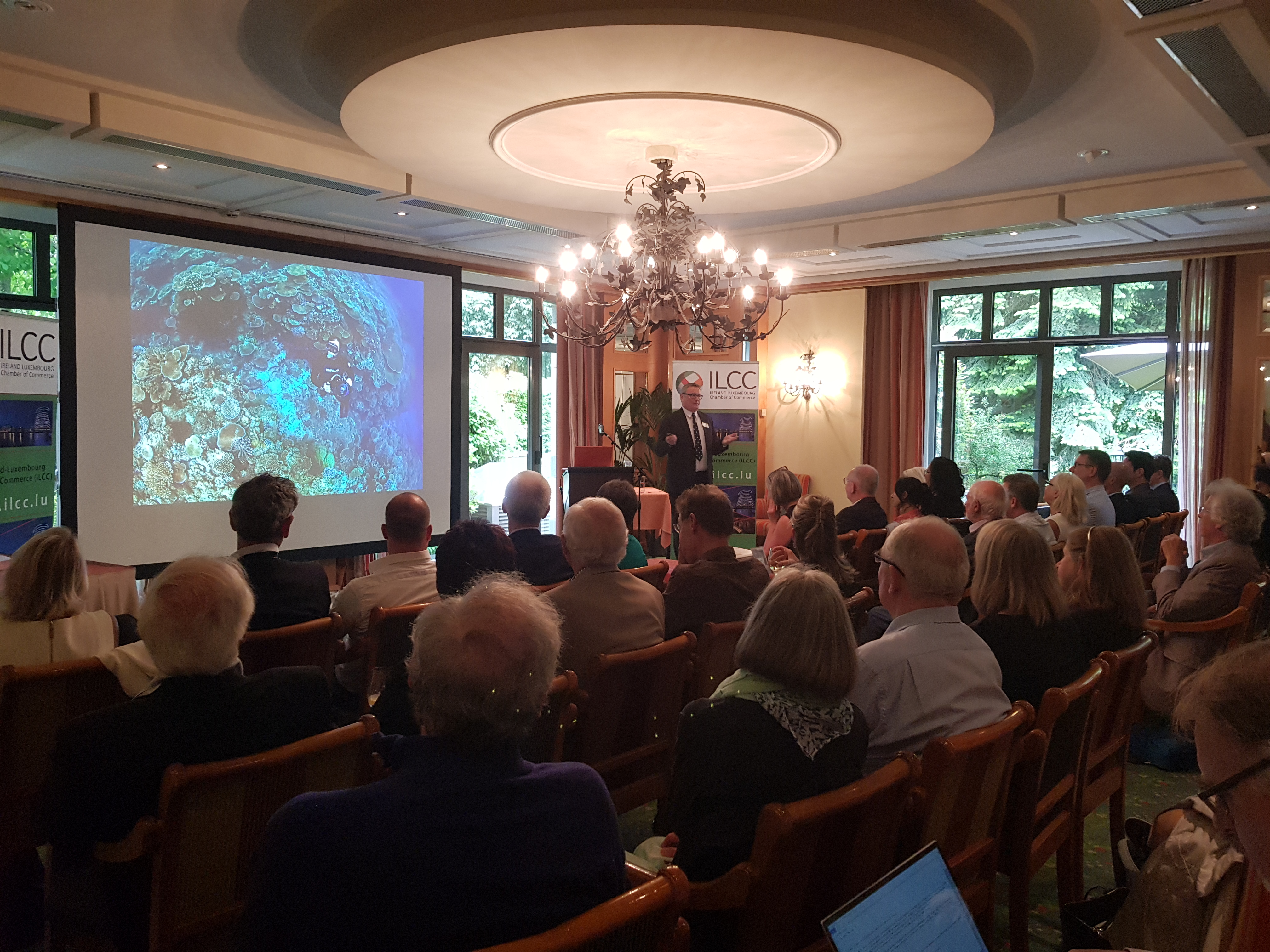 David Jones speaking to packed audience about plastic pollution