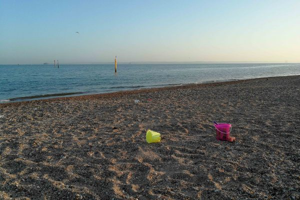 plastic buckets left on the beach
