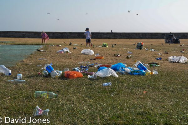Boy playing in plastic waste in Southsea