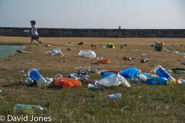 Boy running through plastic waste in Southsea